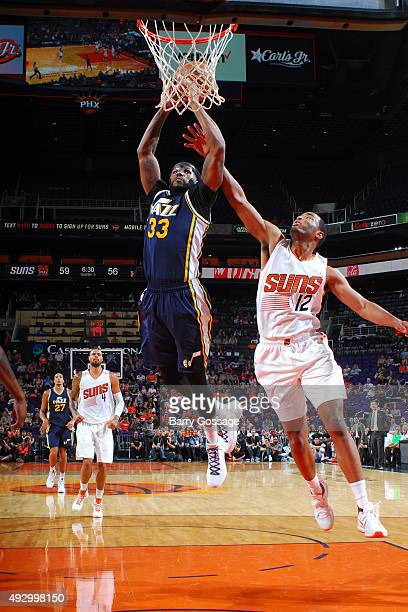 Trevor Booker of the Utah Jazz goes up for a dunk against the Phoenix Suns during a preseason game on October 9 at Talking Stick Resort Arena in...