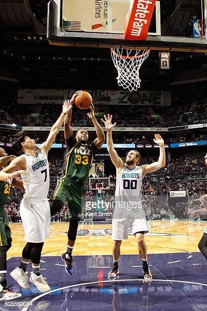 Trevor Booker of the Utah Jazz shoots the ball against the Charlotte Hornets on January 18 2016 at Time Warner Cable Arena in Charlotte North...