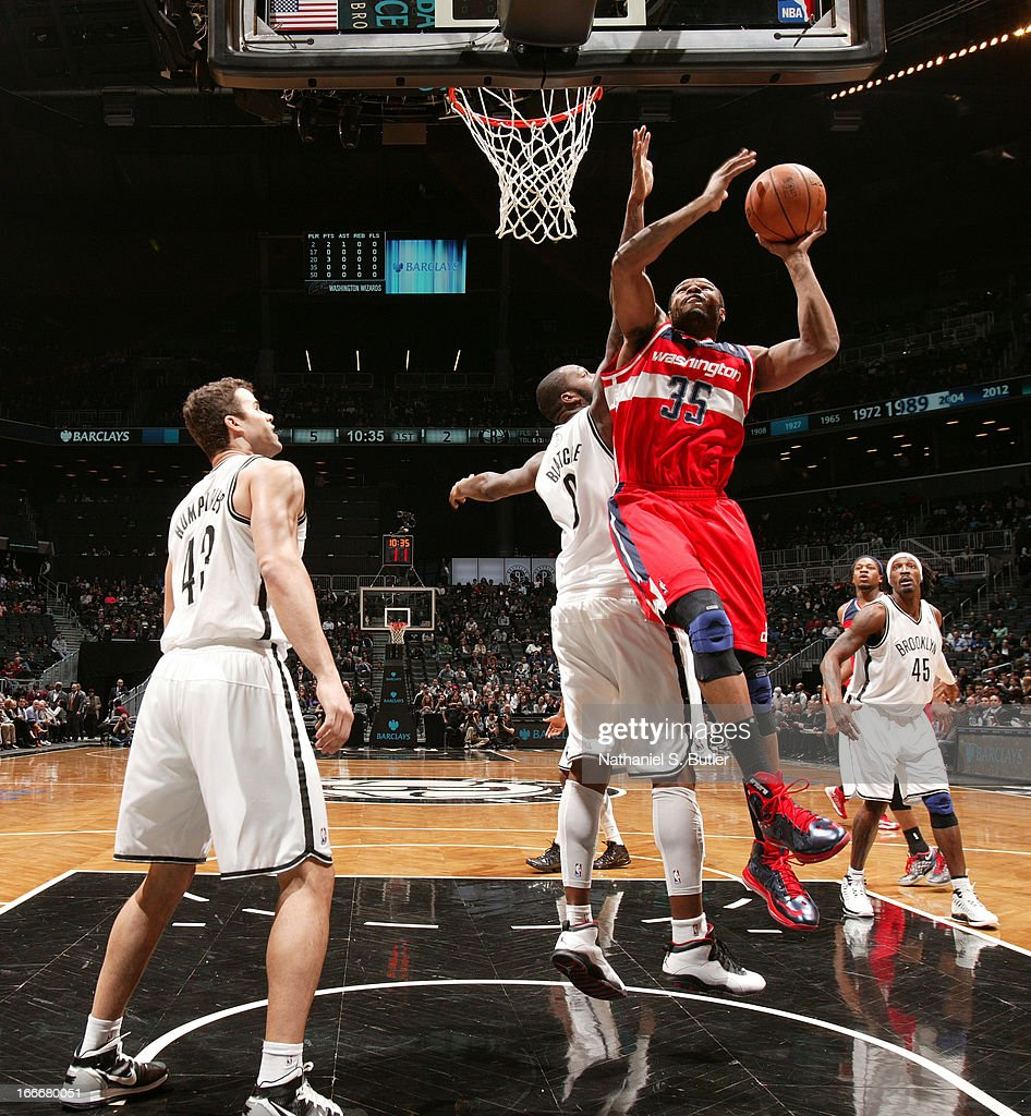 Trevor Booker #35 of the Washington Wizards shoots against Andray Blatche #0 of the Brooklyn Nets on April 15, 2013 at the Barclays Center in the Brooklyn borough of New York City.