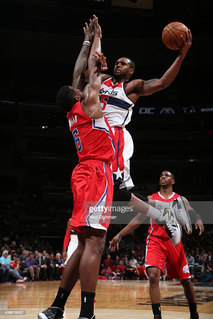Trevor Booker #35 of the Washington Wizards shoots against DeAndre Jordan #6 of the Los Angeles Clippers during the game at the Verizon Center on December 14, 2013 in Washington, DC.