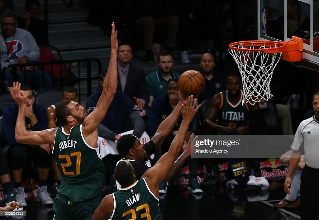 Trevor Brooker (C) of Brooklyn Nets in action against Rudy Gobert (27) of Utah Jazz during NBA game between Brooklyn Nets and Utah Jazz at Barclays Center in New York City, United States on January 03, 2017.