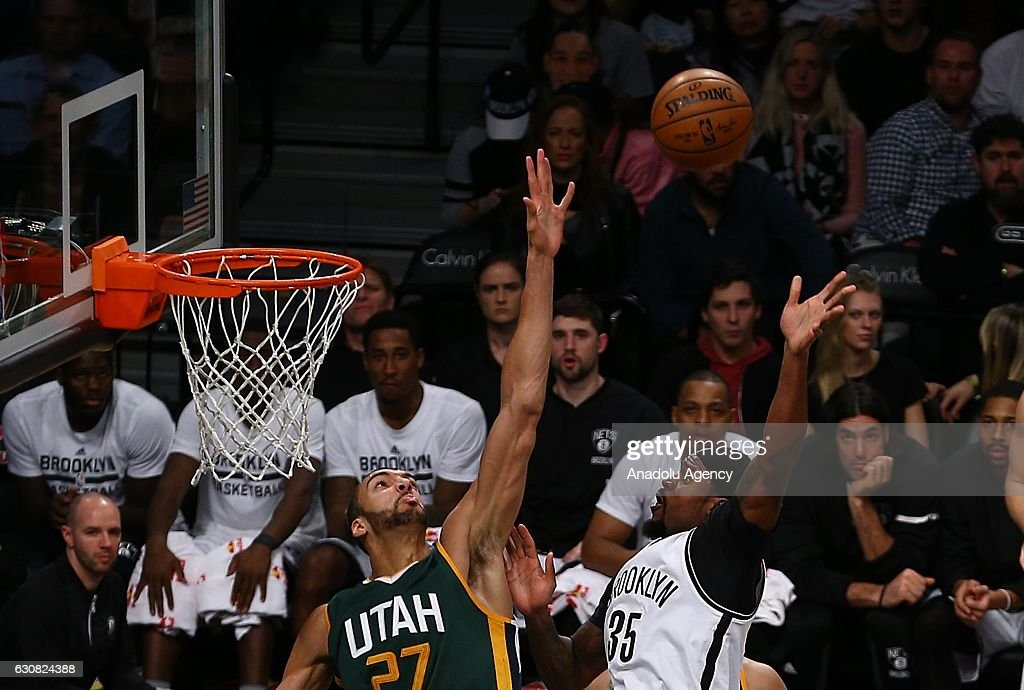 Trevor Brooker (R) of Brooklyn Nets in action against Rudy Gobert (L) of Utah Jazz during NBA game between Brooklyn Nets and Utah Jazz at Barclays Center in New York City, United States on January 03, 2017.