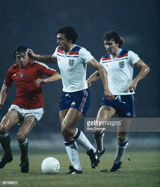Trevor Brooking and Bryan Robson in action for England during their World Cup Qualifying match against Hungary at Wembley Stadium 18th November 1981...