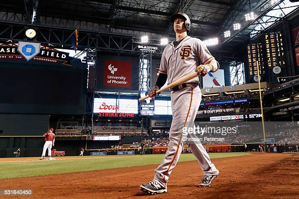 Trevor Brown of the San Francisco Giants walks out of the dugout before batting during the third inning of the MLB game against the Arizona...