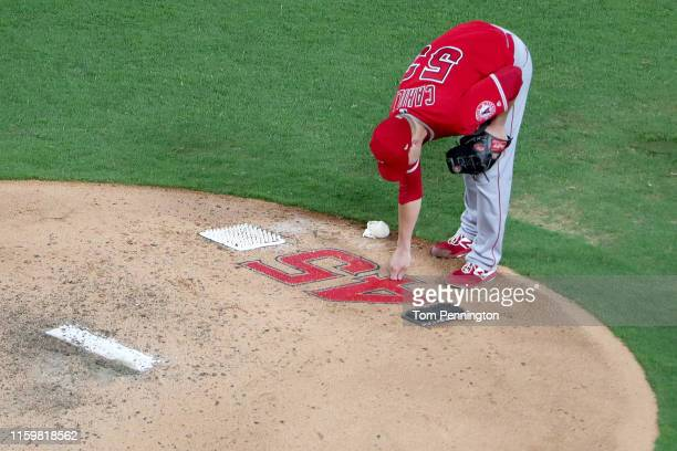 Trevor Cahill of the Los Angeles Angels takes the mound against the Texas Rangers in the bottom of the fifth inning at Globe Life Park in Arlington...