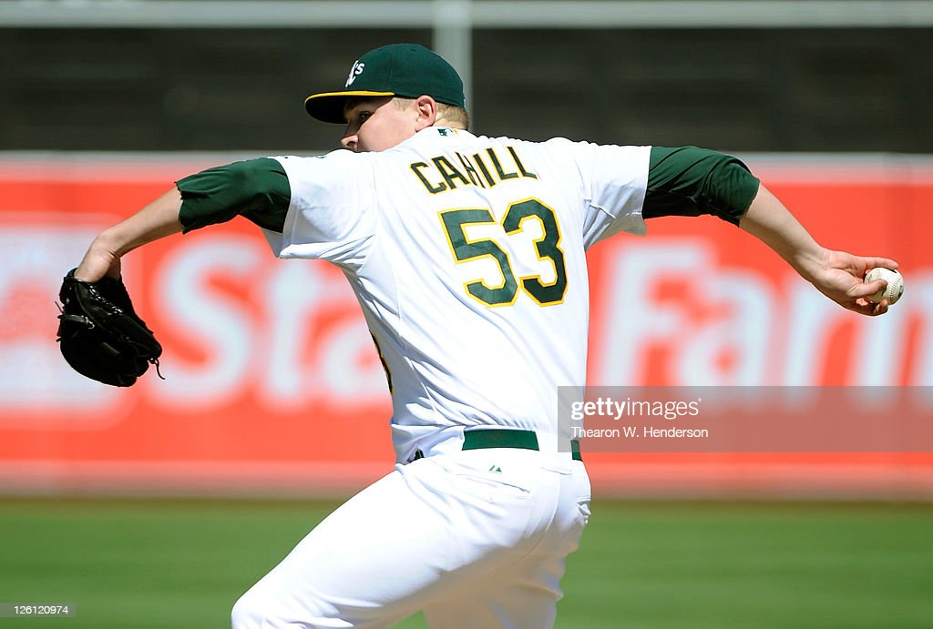 Trevor Cahill #53 of the Oakland Athletics pitches against the Texas Rangers during an MLB basebll game at O.co Coliseum on September 22, 2011 in Oakland, California.