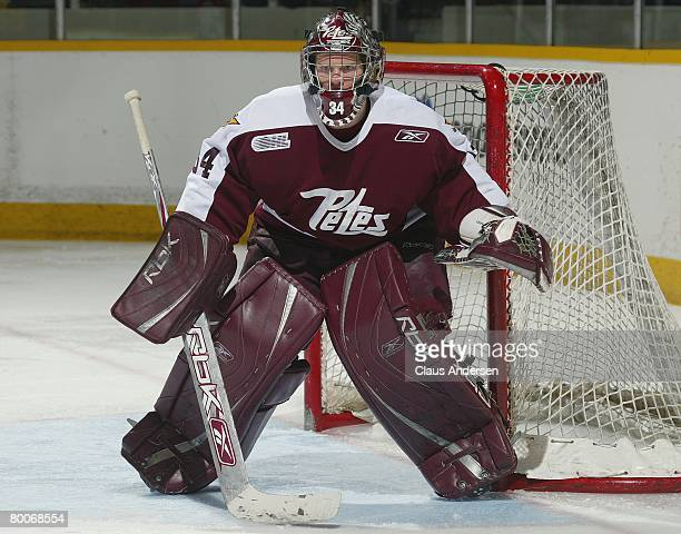 Trevor Cann of the Peterborough Petes keeps an eye on the play in a game against the Oshawa Generals on February 28 2008 at the Peterborough Memorial...