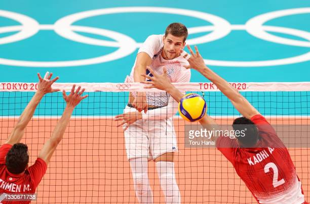 Trevor Clevenot of Team France attacks against Mohamed Ali Ben Othmen Miladi of Team Tunisia and Ahmed Kadhi during the Men's Preliminary Round -...