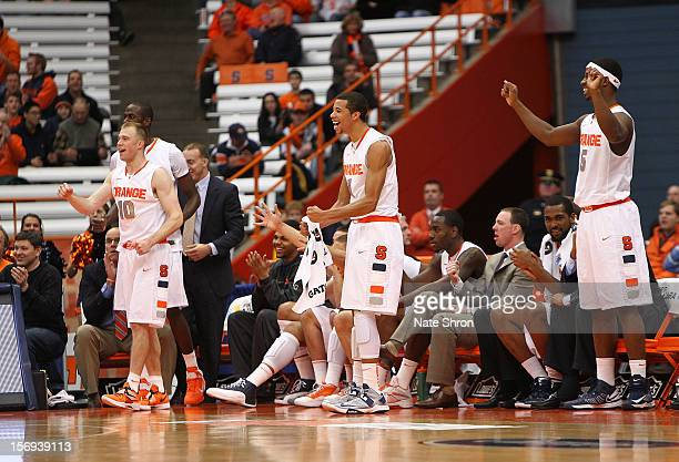 Trevor Cooney Michael CarterWilliams and CJ Fair of the Syracuse Orange stand and chair on the sideline during the win over the Colgate Raiders at...