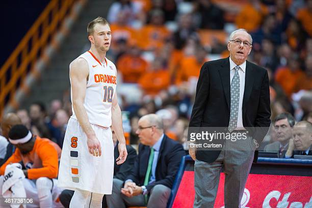 Trevor Cooney of the Syracuse Orange and head coach Jim Boeheim talk during a free throw in the first half against the Florida State Seminoles on...