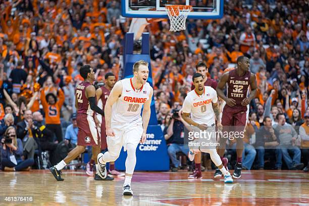 Trevor Cooney of the Syracuse Orange celebrates a three point shot during the second half against the Florida State Seminoles on January 11 2015 at...