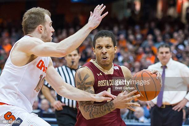 Trevor Cooney of the Syracuse Orange defends as Dimitri Batten of the Boston College Eagles drives to the basket during the second half on January 20...