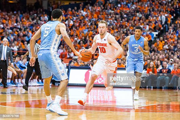 Trevor Cooney of the Syracuse Orange dribbles downcourt as Marcus Paige of the North Carolina Tar Heels defends on January 9 2016 at The Carrier Dome...
