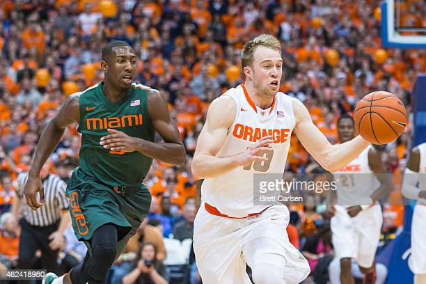 Trevor Cooney of the Syracuse Orange dribbles on a breakaway as Davon Reed of the Miami Hurricanes plays catch up on January 24 2015 at The Carrier...