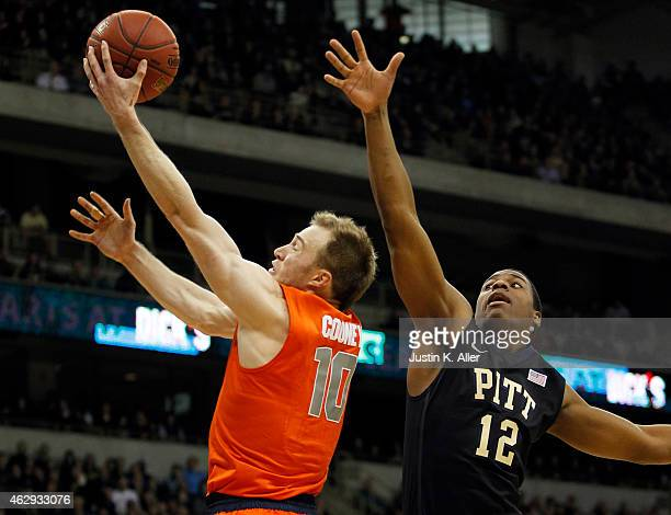 Trevor Cooney of the Syracuse Orange drives to the basket against Chris Jones of the Pittsburgh Panthers during the game at Petersen Events Center on...