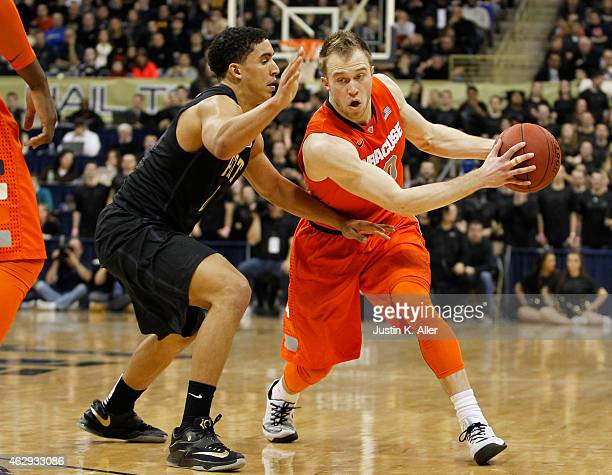Trevor Cooney of the Syracuse Orange handles the ball against James Robinson of the Pittsburgh Panthers during the game at Petersen Events Center on...
