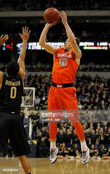 Trevor Cooney of the Syracuse Orange pulls up for a shot against the Pittsburgh Panthers during the game at Petersen Events Center on February 7 2015...
