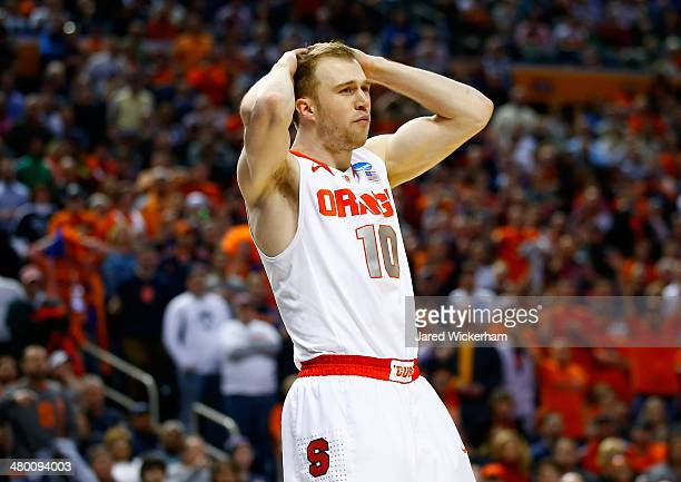 Trevor Cooney of the Syracuse Orange reacts against the Dayton Flyers during the third round of the 2014 NCAA Men's Basketball Tournament at the...