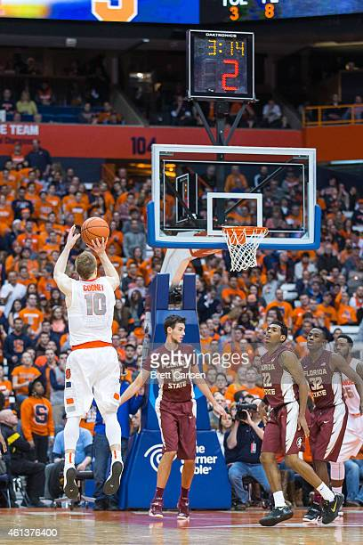 Trevor Cooney of the Syracuse Orange shoots a three point shot during the second half against the Florida State Seminoles on January 11 2015 at The...