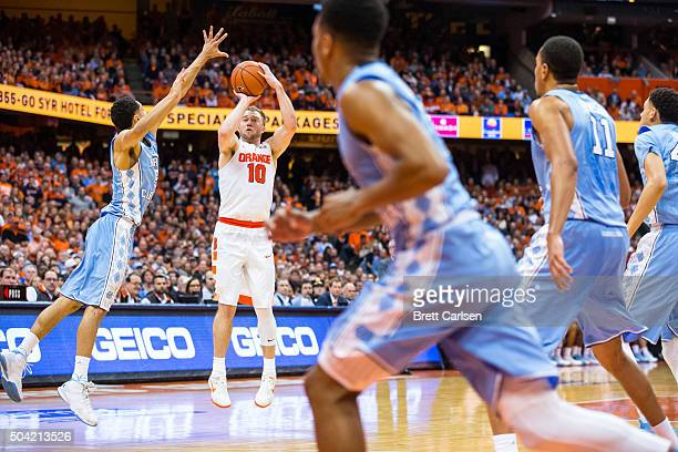 Trevor Cooney of the Syracuse Orange shoots a three point shot during the second half against the North Carolina Tar Heels on January 9 2016 at The...