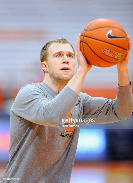Trevor Cooney of the Syracuse Orange takes a shot prior to the game against the Indiana Hoosiers at the Carrier Dome on December 3 2013 in Syracuse...