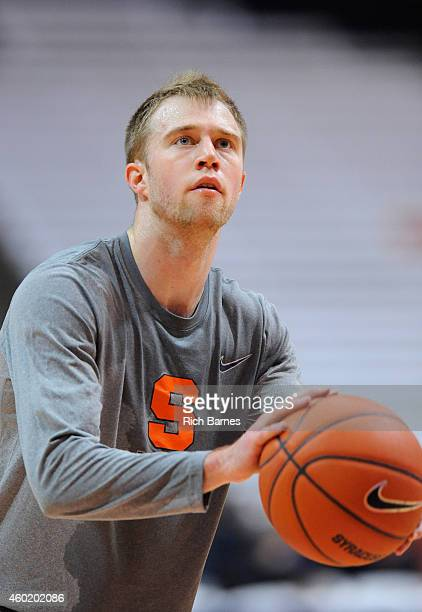 Trevor Cooney of the Syracuse Orange warms up prior to the game against the St John's Red Storm at the Carrier Dome on December 6 2014 in Syracuse...