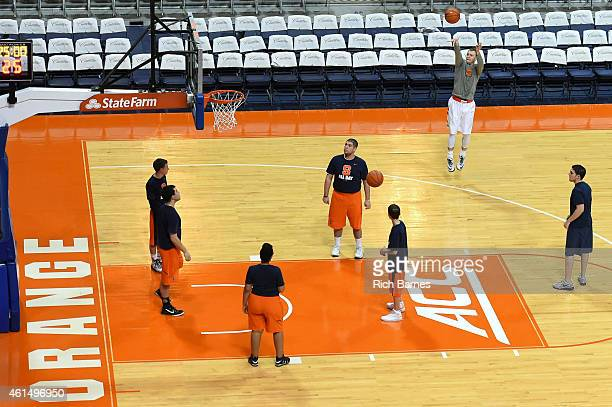 Trevor Cooney of the Syracuse Orange warms up prior to the game against the Wake Forest Demon Deacons at the Carrier Dome on January 13 2015 in...