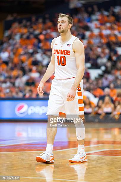 Trevor Cooney of the Syracuse Orange watches teammates during the game against the Colgate Raiders on December 8 2015 at The Carrier Dome in Syracuse...