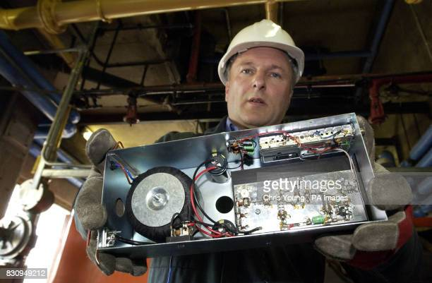 Trevor Cullimore an engineer at the Radio Communications Agency holds a radio transmitter from a pirate radio station found in a boiler room in a...