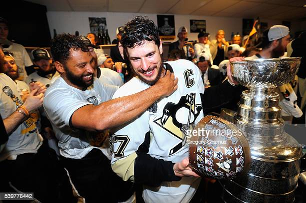 Trevor Daley and Sidney Crosby of the Pittsburgh Penguins celebrate with the Stanley Cup in the locker room after winning Game 6 of the 2016 NHL...