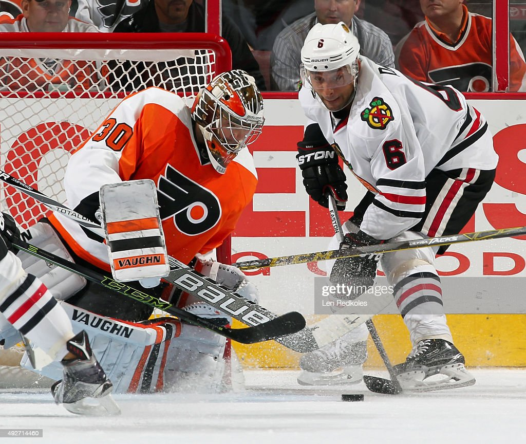 Trevor Daley #6 of the Chicago Blackhawks attempts a scoring chance against Michal Neuvirth #30 of the Philadelphia Flyers on October 14, 2015 at the Wells Fargo Center in Philadelphia, Pennsylvania. The Flyers went on to defeat the Blackhawks 3-0.