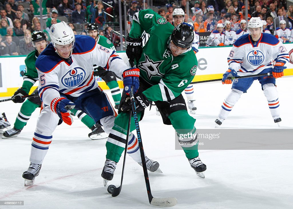 Trevor Daley #6 of the Dallas Stars handles the puck against Mark Fayne #5 of the Edmonton Oilers at the American Airlines Center on November 25, 2014 in Dallas, Texas.