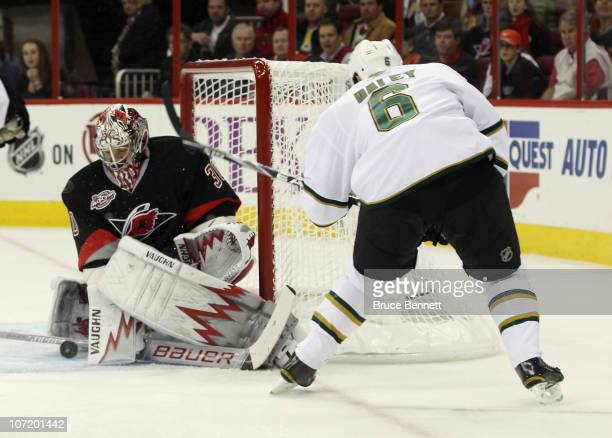 Trevor Daley of the Dallas Stars is stopped in the first period by goaltender Cam Ward of the Carolina Hurricanes at the RBC Center on November 29...