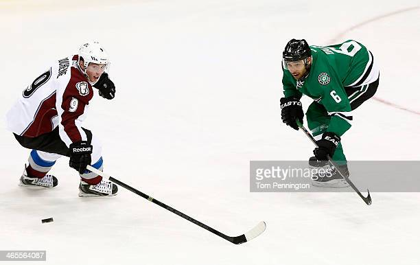 Trevor Daley of the Dallas Stars passes the puck against Matt Duchene of the Colorado Avalanche in the third period at American Airlines Center on...