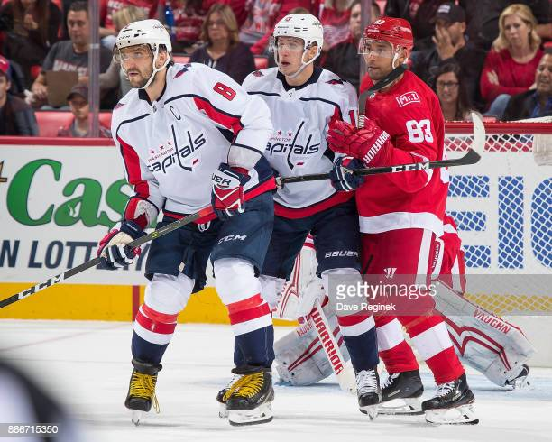 Trevor Daley of the Detroit Red Wings battles in front of the net with Jakub Vrana and Alex Ovechkin of the Washington Capitals during an NHL game at...