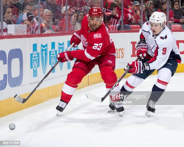 Trevor Daley of the Detroit Red Wings races after the puck next to Dmitry Orlov of the Washington Capitals during an NHL game at Little Caesars Arena...