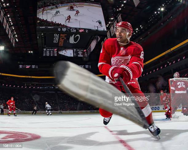 Trevor Daley of the Detroit Red Wings skates after a loose puck along the boards during an NHL game against the Los Angeles Kings at Little Caesars...