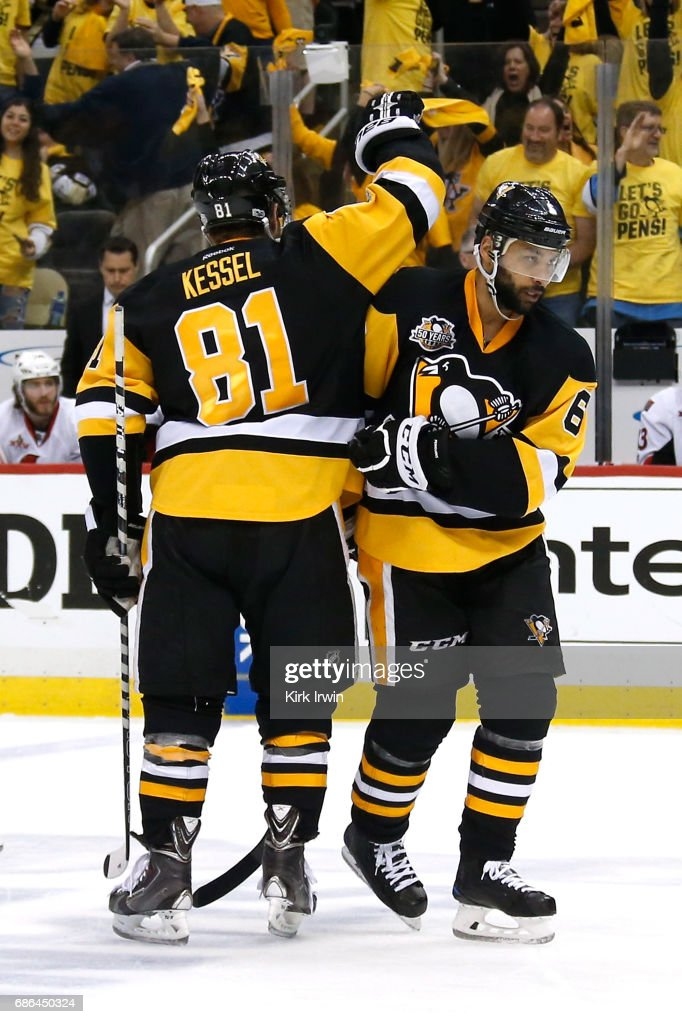 Trevor Daley #6 of the Pittsburgh Penguins celebrates with his teammate Phil Kessel #81 after scoring a goal against Mike Condon #1 of the Ottawa Senators during the third period in Game Five of the Eastern Conference Final during the 2017 NHL Stanley Cup Playoffs at PPG PAINTS Arena on May 21, 2017 in Pittsburgh, Pennsylvania.