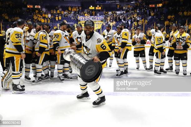 Trevor Daley of the Pittsburgh Penguins celebrates with the Stanley Cup trophy after defeating the Nashville Predators 20 in Game Six of the 2017 NHL...