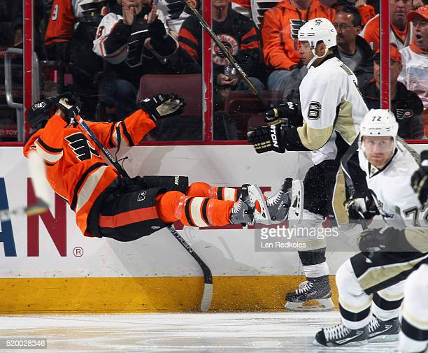 Trevor Daley of the Pittsburgh Penguins checks Brayden Schenn of the Philadelphia Flyers to the ice on April 9 2016 at the Wells Fargo Center in...
