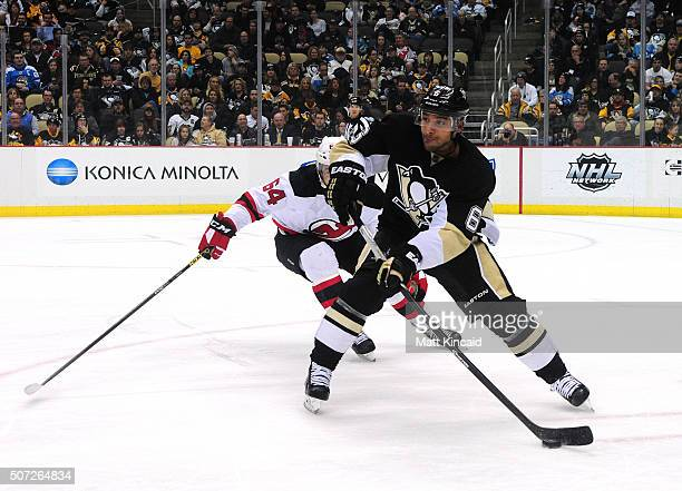 Trevor Daley of the Pittsburgh Penguins skates with the puck against the New Jersey Devils at Consol Energy Center on January 26 2016 in Pittsburgh...