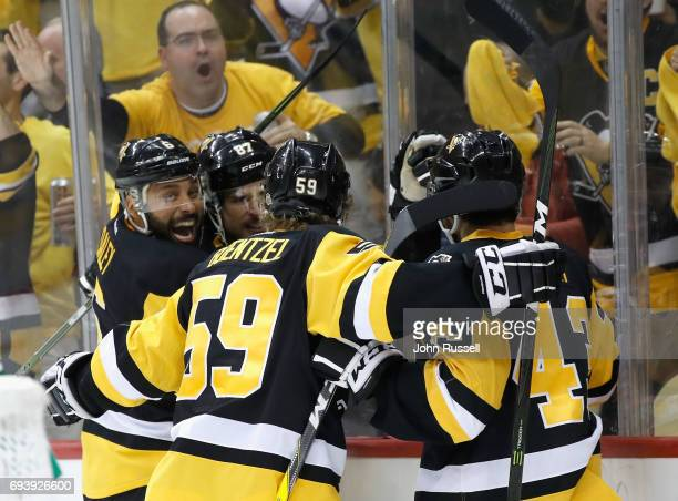 Trevor Daley Sidney Crosby Jake Guentzel of the Pittsburgh Penguins celebrate with teammate Conor Sheary after his goal during the second period of...