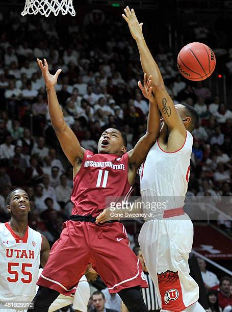 Trevor Dunbar of the Washington State Cougars and Jordan Loveridge of the Utah Utes try for the rebound during the second half of Utah's 8664 win at...