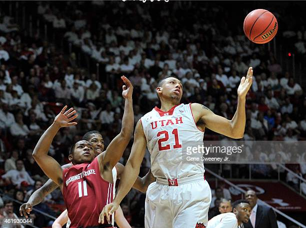 Trevor Dunbar of the Washington State Cougars and Jordan Loveridge of the Utah Utes can't handle the rebound during the second half of Utah's 8664...