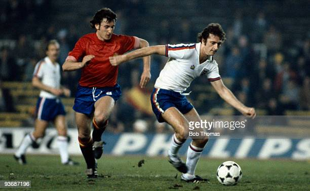 Trevor Francis of England with Enrique Saura of Spain during the Spain v England Friendly International match played at the Nou Camp Stadium in...