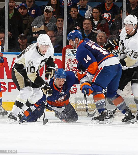 Trevor Gillies and Michael Haley of the New York Islanders pursue a loose puck against Mark Letestu of the Pittsburgh Penguins on April 8 2011 at...