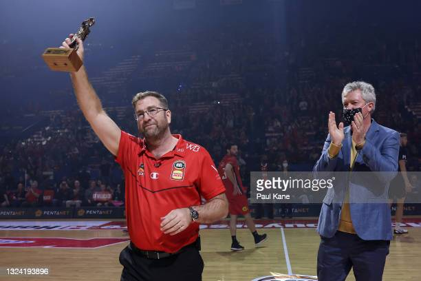 Trevor Gleeson, coach of the Wildcats acknowledges the supporters after being presented the 2021 NBL Coach Of The Year trophy by former Wildcats head...