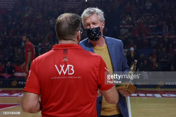 Trevor Gleeson, coach of the Wildcats is presented the 2021 NBL Coach Of The Year trophy by former Wildcats head coach Alan Black during game one of...
