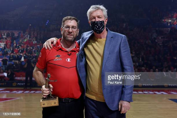 Trevor Gleeson, coach of the Wildcats poses with former Wildcats head coach Alan Black after being presented the 2021 NBL Coach Of The Year trophy...