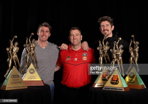 Trevor Gleeson, senior coach of the Wildcats poses with his NBL Championship trophies together with Damian Martin and Greg Hire after announcing he...